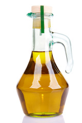 Small bottle of olive oil with cork stopper in front
