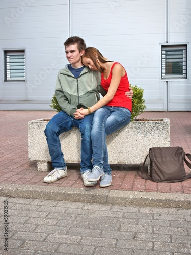 Boy and girl, teens clinging to each other