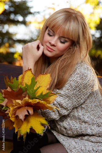 Young woman with autumn garden background
