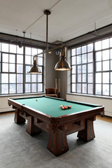Pool table in loft style apartment