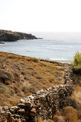 Rock wall leading downhill to Mediterranean sea