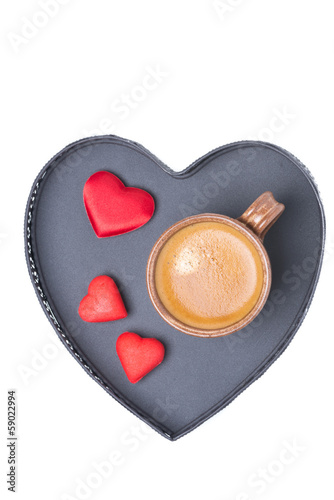 cup of coffee and candy on a tray in the form of heart, isolated