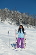 Girl with the skis at the ski slope