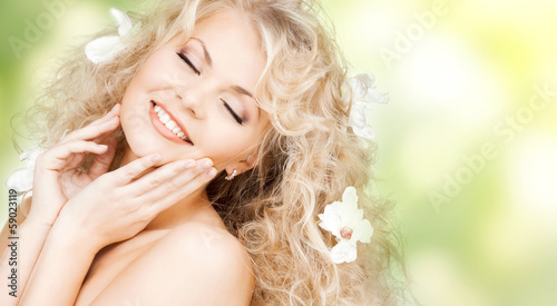 happy woman with flowers in hair