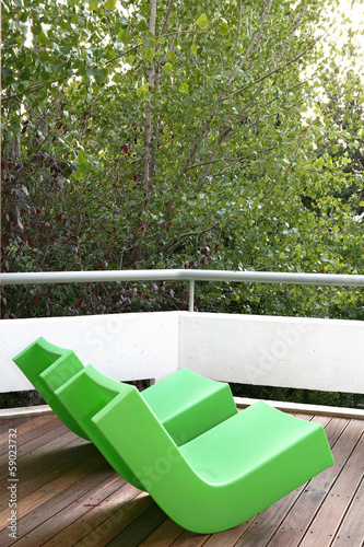 Green chairs on deck
