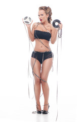 Attractive woman with an audio retro bobbins