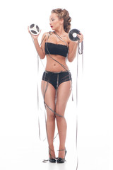 Attractive woman with an audio retro bobbins