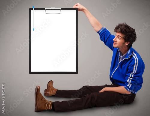 Young boy holding black folder with white sheet copy space