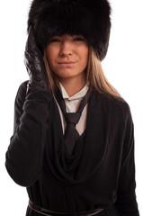 Beautiful woman with a headache wearing a fur hat