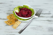 Beet salad in bowls on wooden table
