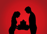 Silhouettes of couple with gift