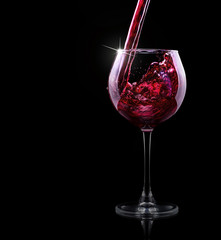 glass of red splashing wine