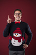 Funny nerdy man wearing sweater with snowman has brilliant idea