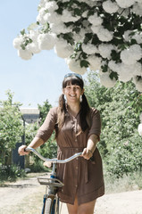 Woman smiling as she admires spring blossom