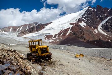 Abandoned bulldozer in mountains. Kyrgyzstan