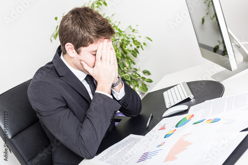 Stressed Young Businessman at Office