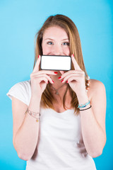 Smiling Girl Holding Smartphone with Blank Screen