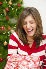Girl laughing while receiving Christmas gift