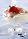 Closeup of creamy tiramisu with strawberries.