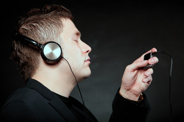young man with headphones use mp3 music player