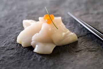 fresh scallop sashimi with red caviar.