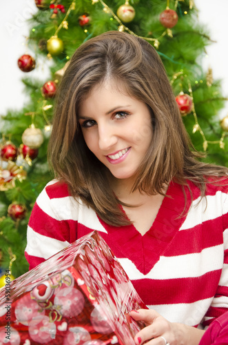 Beautiful girl holding Christmas gift