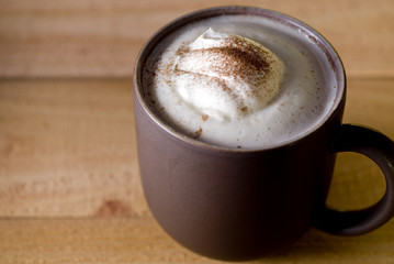 hot chocolate or espresso drink with a dollop of whipped cream.