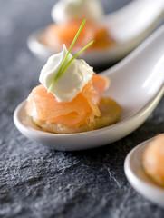 three smoked salmon gourmet appetizers on potato pancakes