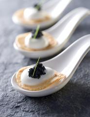 caviar, creme fraiche and fried slices of potato.
