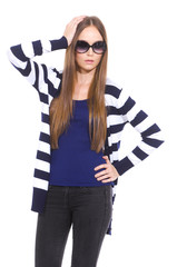 young woman in sunglasses with stripy shirt standing