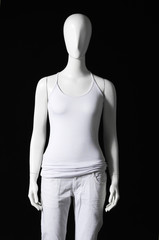 Mannequin dressed in white t-shirt and trousers