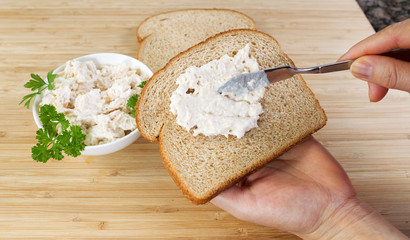 Preparing a tuna fish sandwich
