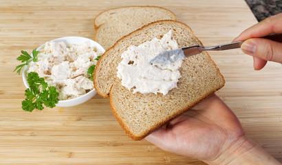 Preparing a tuna fish sandwich