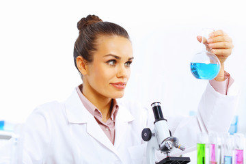Young female scientist working in laboratory