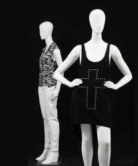 Two mannequin dressed fashionably with black dress and isolated