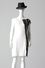 stylish dress with hat isolated on a mannequin