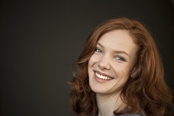 Young Woman with Beautiful Blue Eyes and Red Hair