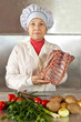 Cook woman with meat and vegetables