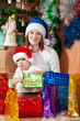 mother and  son with Christmas gifts