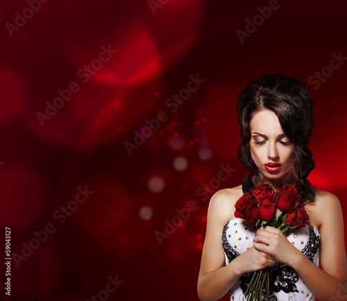 Dreamy Woman with Bouquet of Flowers over Purple Background
