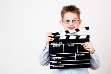 Boy holding clapper board