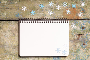 Christmas background with empty notepad on wood