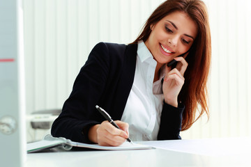 Young cheerful businesswoman talking