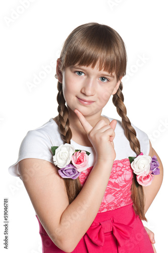 Young pensive girl on the white background