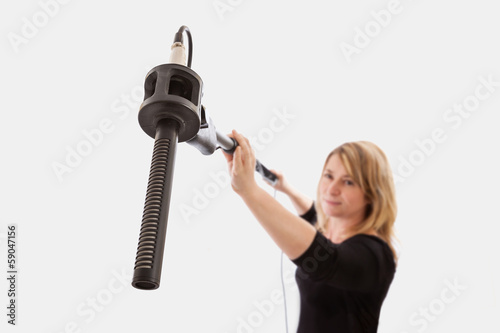 Woman Using Microphone Boom