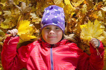 Funny autumn portrait of young girl