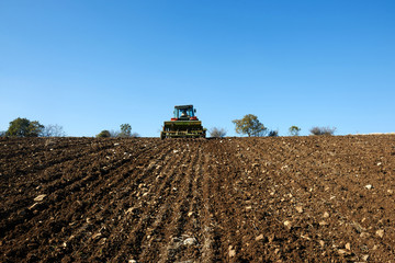 agricultural tractor sowing seeds