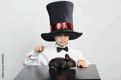 little funny magician with rabbit