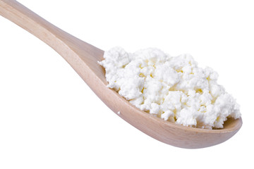 Cottage cheese in wooden spoon isolated on white