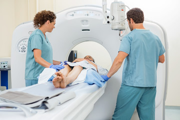 Nurses Preparing Patient For CT Scan